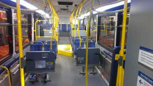 The interior of the new CNG bus showing the courtesy screens