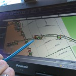 Burney using the TMAC GPS system to find buses in need of repair