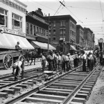 Laying the line for streetcars at Granville and Robson, Vancouver