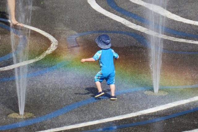 Child playing in the spray park
