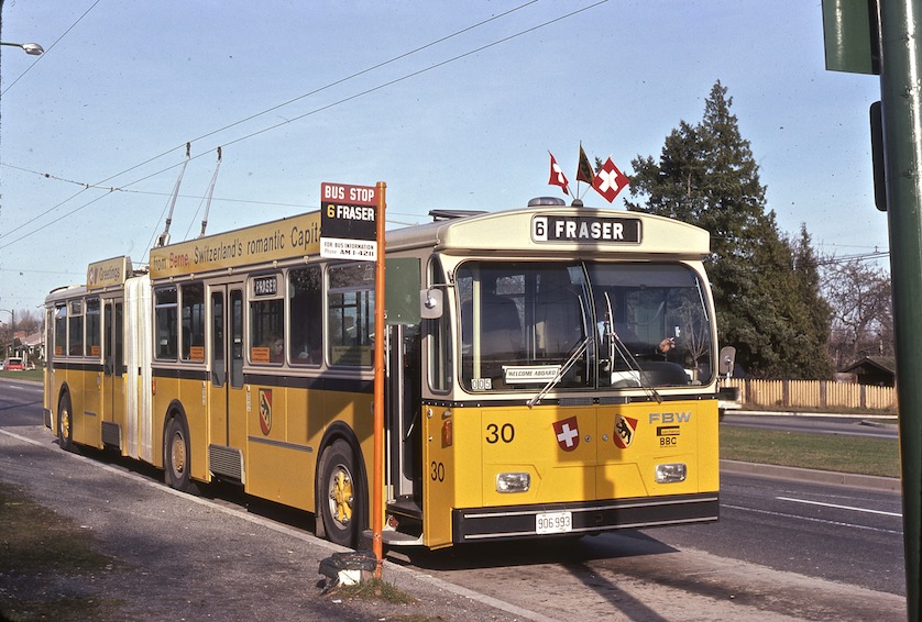 Hess articulated trolley demonstrator on loan from Berne, Switzerland in 1974. Shown at Cambie and 64th terminus. Note bus information number is Amherst 1-4211.