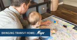 Picture of a parent and toddler looking at TransLink map