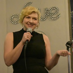 Pamela Findling performing at a comedy show