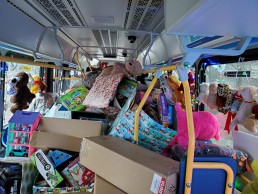 A bus load of toys for Toys for Tots.
