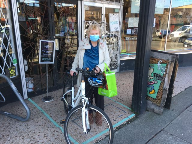 Linda picking up her bike from Our Community Bikes.