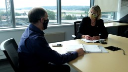 Derek Stewart and Dorit Mason reviewing safety plans