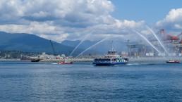 The Burrard Chinook SeaBus sails through a water salute