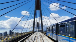 The SkyTrain travelling inbound on the SkyBridge