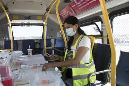 A nurse preparing onboard the mobile vaccine bus