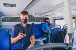 Customers with masks onboard the double-decker bus