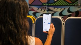 Customer using the Transit app onboard the Burrard Chinook SeaBus