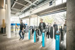 Passengers walkthrough Compass fare gates.