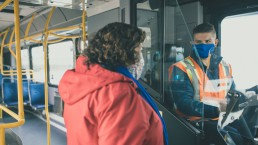 Customer speaking to a bus operator